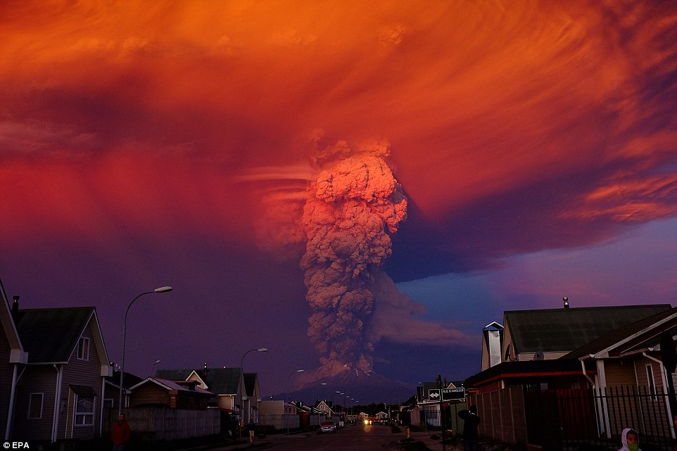 Up in smoke:Volcano Calbuco, in southern Chile, has erupted forcing 1,500 residents from Ensenada, about 10 miles away,  to flee their homes (pictured, a view of the eruption from Puerto Montt, a small city around 20 miles from the volcano)