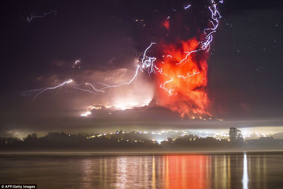 An electrical storm lights up the night sky as a huge column of ash and lava shoots out of the volcano. The eruption sparked a red alert in the port city of Puerto Montt