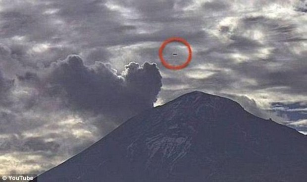 Unusual circular orbs a long cigar-shaped anomaly were spotted on the cameras of Webcams Mexico above the Popocatepetl volcano. The lights appeared at the same time as the 18,000ft volcano released 4 explosions. Acigar-UFO is seen in this image horizontally over the same volcano in February this year