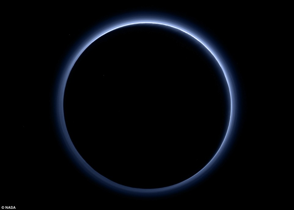 Pluto's haze layer shows its blue colour in this image. The high-altitude haze is thought to be similar in nature to that seen at Saturn's moon Titan. The source of both hazes likely involves sunlight-driven chemical reactions of nitrogen and methane, leading to relatively small, soot-like particles (called tholins) that grow as they settle toward the surface