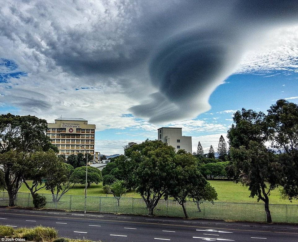 Meteorologists call them lenticular clouds, and they form when strong, wet winds blow over rough terrain, - such as the 3,500-foot (1,066-meter) Table Mountain.