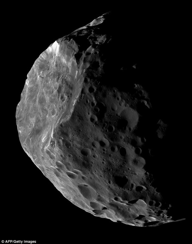 Saturn's moon Phoebe (pictured) is likely to be a giant comet or a centaur that was captured by that planet's gravity at some time in the past