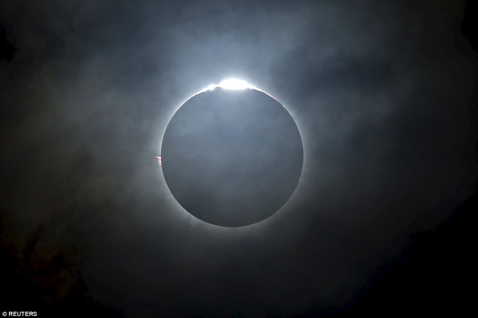 Thousands of tourists and astronomy enthusiasts flocked to Indonesia last month to catch the country's first solar eclipse in nearly 33 years. The eclipse was also visible in parts of Australia and south-east Asia. The total solar eclipse as seen from the beach on Ternate island, Indonesia is pictured