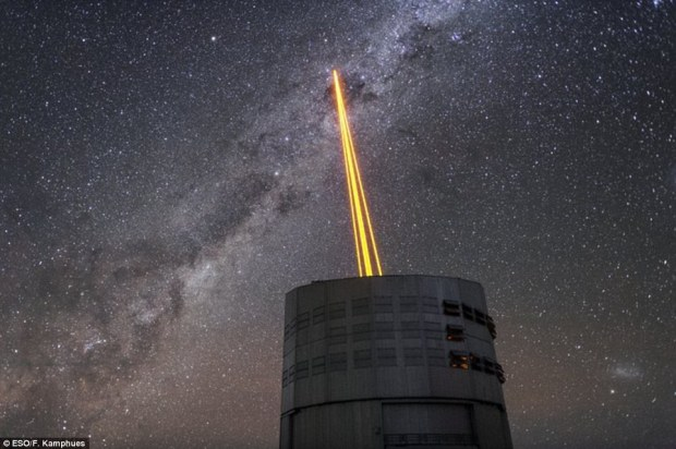 Four powerful laser beams cut through the sky above the Paranal Observatory in Chile on Tuesday, forming massive artificial stars that will light the way for astronomical research. The new system creates the most powerful laser guide stars ever used, and makes up a crucial component of the ESO¿s Very Large Telescope
