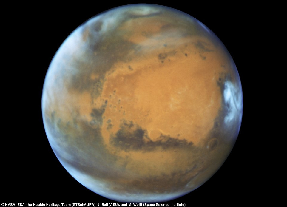 The Hubble Space Telescope view was taken on May 12, 2016, when Mars was 50 million miles from Earth, and reveals details as small as 20 to 30 miles across.