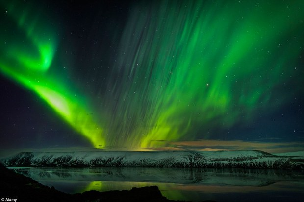 On Earth the aurora - known as the Northern and Southern Lights - produce colourful but fleeting displays in the night's sky around the poles. These are caused by energetic particles form the solar wind colliding with the gases in the atmopshere (Aurora Borealis as seen in Iceland pictured)