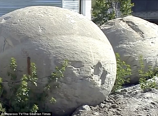Experts say the concretion balls (pictured) form a little like a pearl in a shell fish, with sediment forming around a nucleus like a fossilised creature or a shell