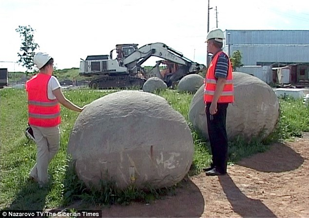 Workers at a coal mine in the Nazarovo district of Siberia's Krasnoyarsk region unearthed 10 giant ball shaped rocks (pictured) under ground. The huge boulders are thought to be concretions of sediment that have formed over millions of years