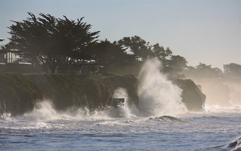 Big waves affect beach access and ocean bluffs at the Isla Vista, California study site.