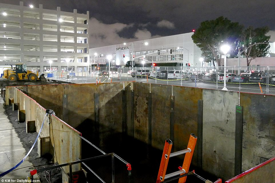 This hole appears to be the site where the 'Boring Company' has begun digging, and is likely where the Tunnel Boring Machine (TBM) - revealed as 'Nannie' by Musk yesterday - was first lowered to begin digging