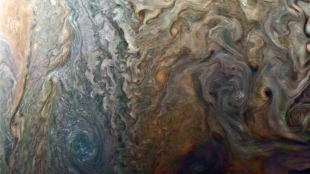 This enhanced-color image of a mysterious dark spot on Jupiter seems to reveal a Jovian