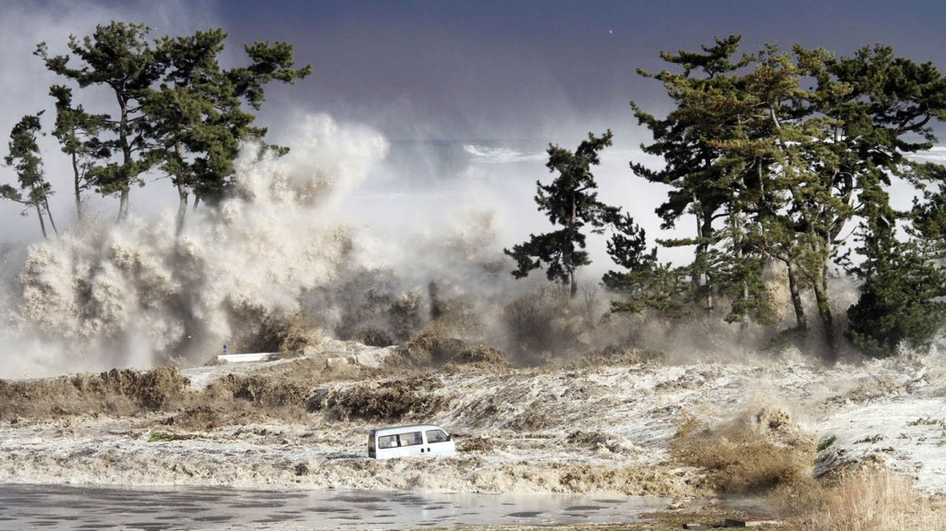 Tsunami waves hitting the coast of Minamisoma in Fukushima prefecture, Japan