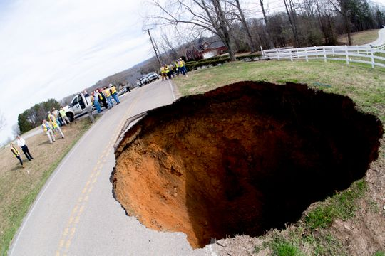 A large sinkhole on Greenwell Road in Powell, Tennessee on Tuesday, February 26, 2019. The sinkhole is estimated to be around 20 feet deep.